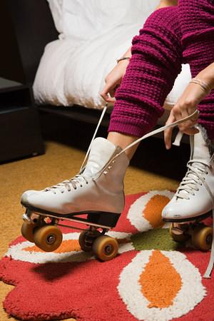 Girl putting on roller skates