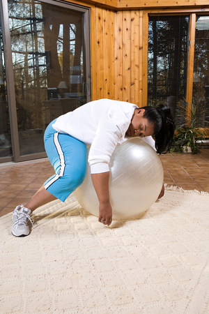 Exhausted woman sleeping on an exercise ball Stock Photo