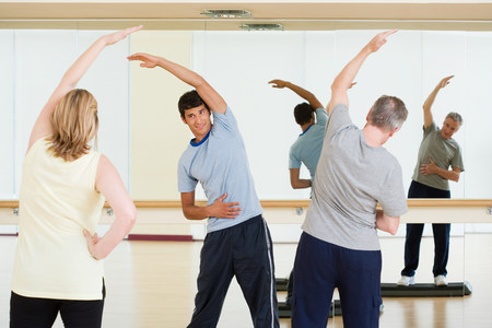 A personal trainer teaching an exercise lesson Stock Photo