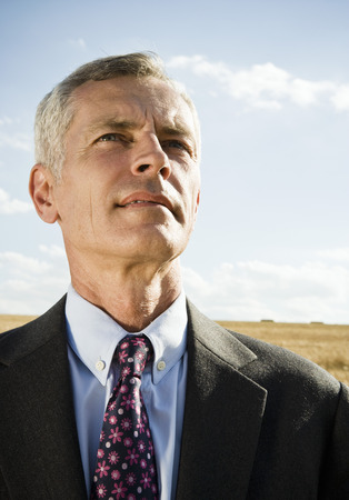 Businessman in a wheat field.