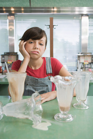 Girl feeling sick after milkshakes