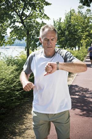 Jogger checking wristwatch Stock fotó - 86036629