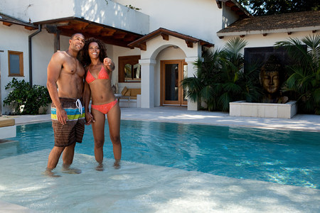 Young couple standing in swimming pool