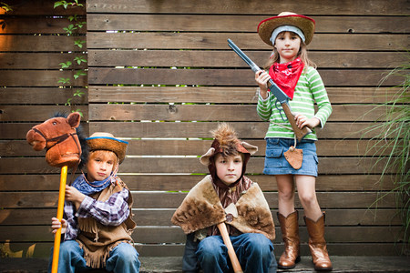 Children dressed up as cowgirl, bear and cowboy