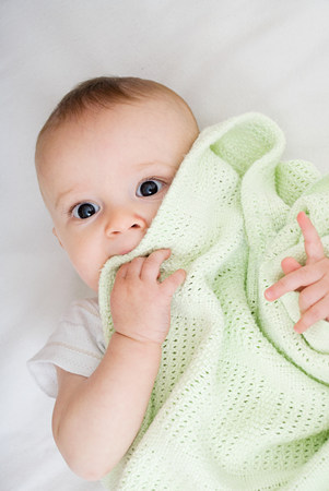 bedspread: Baby with blanket