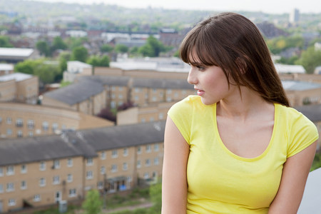 Young woman and urban scene in background Stock Photo