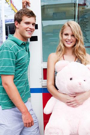 Teenage couple with teddy bear Stock Photo