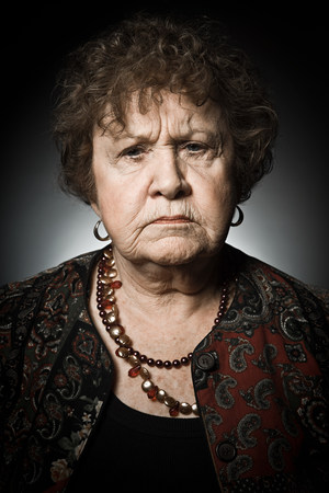 Stuido portrait of angry senior woman
