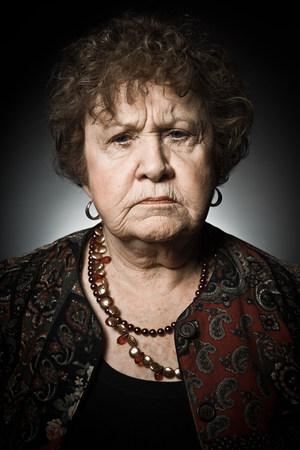 Stuido portrait of angry senior woman