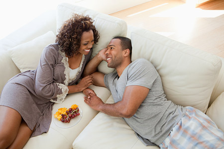 Young couple relaxing on sofa
