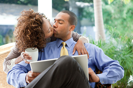 Kissing couple with laptop