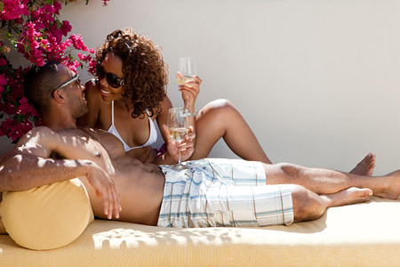Couple relaxing outdoors with wine