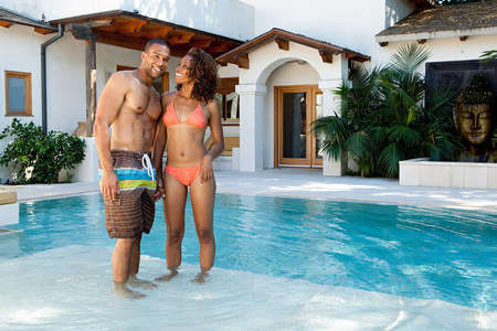 Couple standing in swimming pool