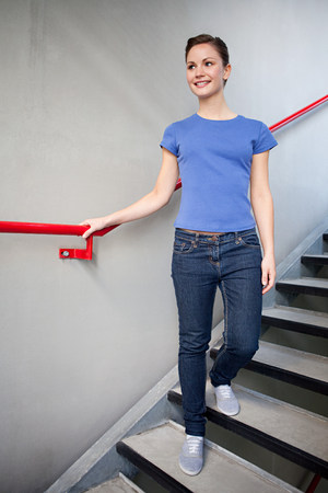 Young woman and stairwell