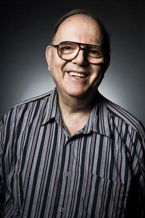 Studio portrait of cheerful senior man