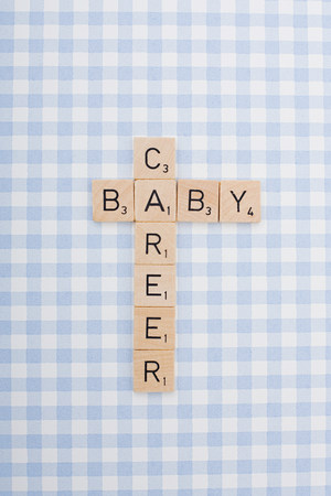 Game tile letters spelling career and baby