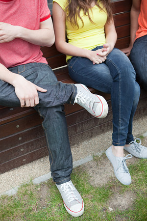 People sitting on a bench Stock Photo