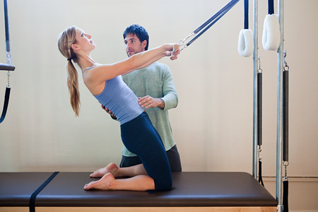 Women doing pilates with instructor
