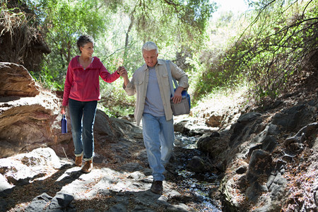 Mature couple walking in forest