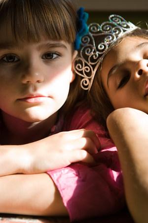 Two girls, one wearing tiara