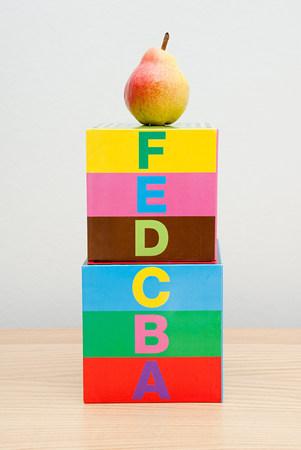 Pear on top of alphabet blocks