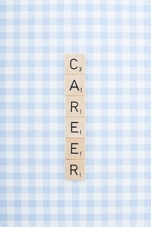 Game tile letters spelling career Stock Photo