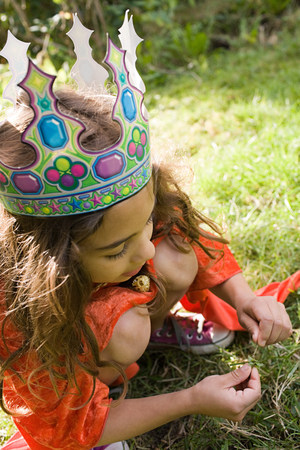 Girl wearing crown dressed up as queen Stock Photo