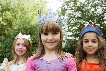 Girls wearing crown dressed up as queens Stock Photo