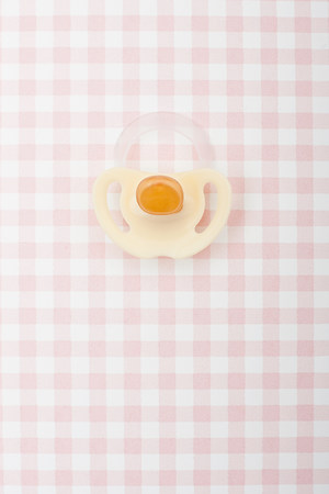 Pacifier on pink checker pattern