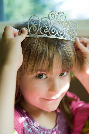 Girl putting on tiara
