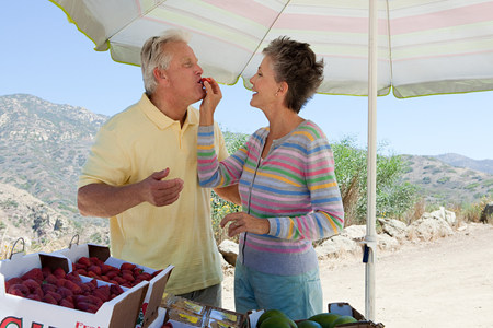 Mature couple at rural fruit stand Stock Photo