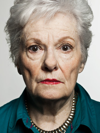 Stuido portrait of serious senior woman