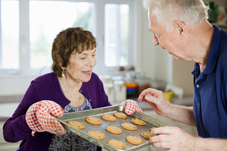 Senior couple with home baked cookies