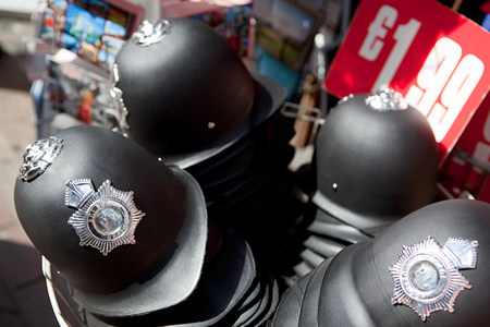 Toy police helmets for sale, London Foto de archivo