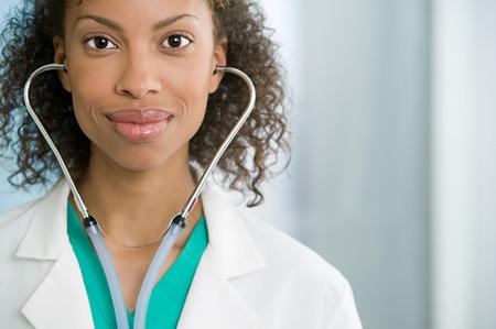 Doctor wearing stethoscope Stock Photo