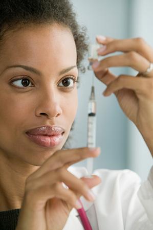 Doctor preparing syringe