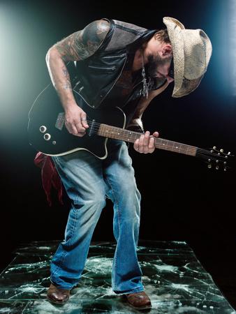 A guitarist playing a guitar