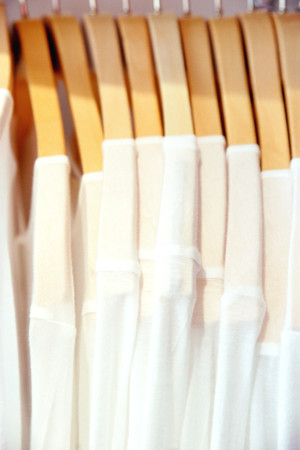 Row of white t-shirts Stock Photo