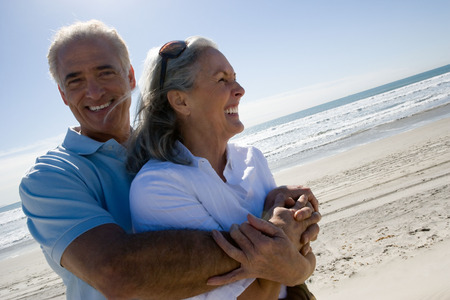 Senior couple embracing on beach Reklamní fotografie