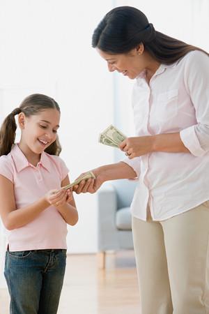 Mother giving daughter pocket money Stok Fotoğraf - 86037257