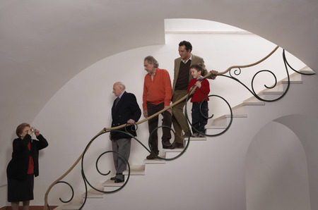 Multigenerational family on staircase posing for photograph Stock Photo