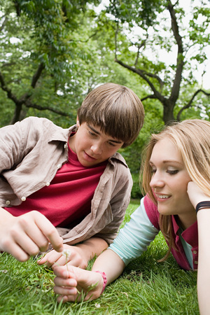 Teenagers relaxing in a park Stock Photo