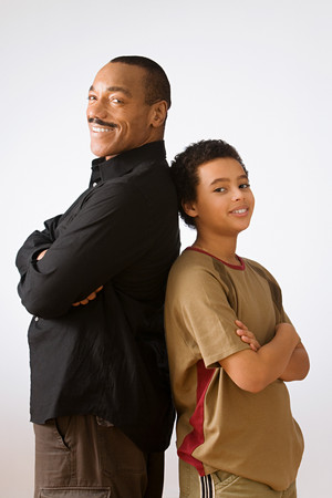 Father and son back to back Stock Photo