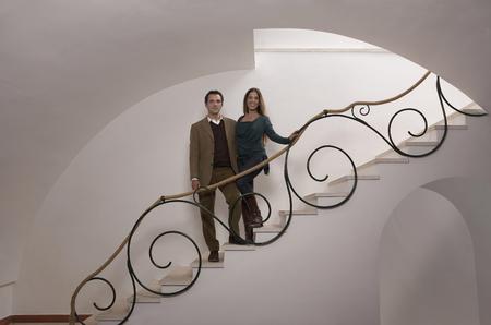 Mature couple on staircase, portrait