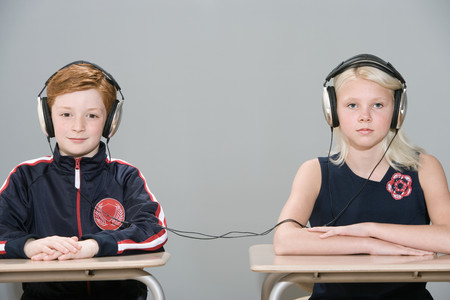 Boy and girl with connected headphones Banco de Imagens