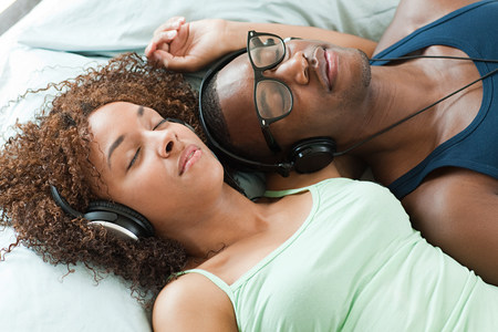 Man and woman listening to music, eyes closed