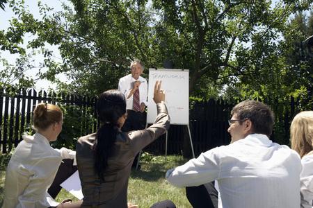 Businesspeople at a rural retreat . Фото со стока