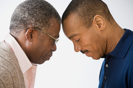 Father and son touching foreheads Stock Photo