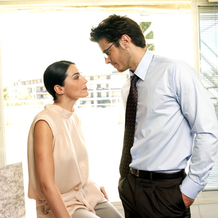 Couple facing each other in office Stock Photo