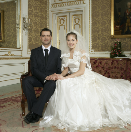 Bride and groom sitting smiling